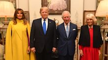 Nato summit: Donald Trump attends reception with the Queen at Buckingham Palace amid protests