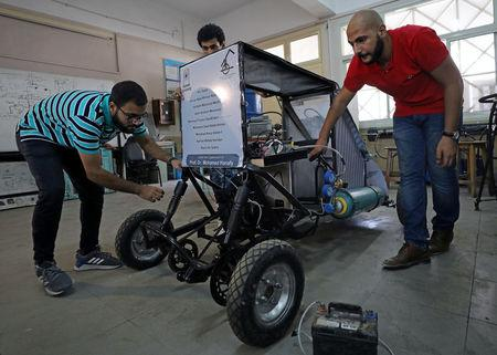 Mechanical engineering students from Helwan University check the air-powered vehicle that they have designed to promote clean energy and battle increasing gas prices, in Cairo, Egypt August 7, 2018. Picture taken August 7, 2018. REUTERS/Mohamed Abd El Ghany