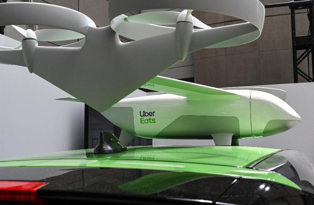 Uber announced it will begin testing drones for food delivery for its Uber Eats service, and over time will land the aircraft on its cars for final delivery (AFP Photo/EVA HAMBACH)