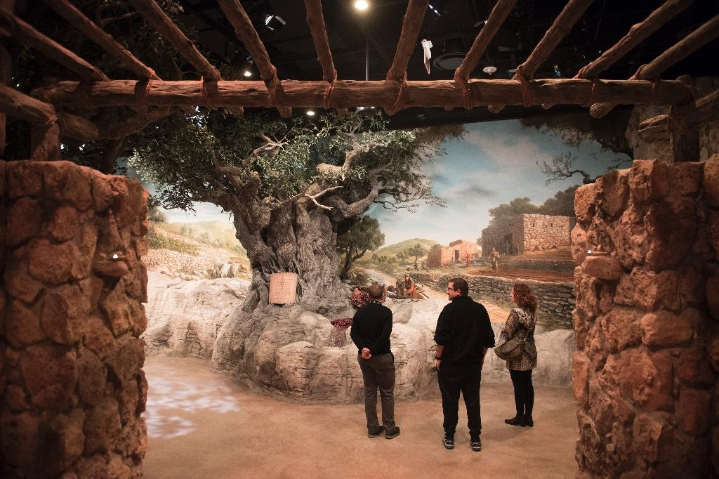 Visitors tour an exhibit recreating what Nazareth may have looked like during Jesus's time (AFP Photo/SAUL LOEB)