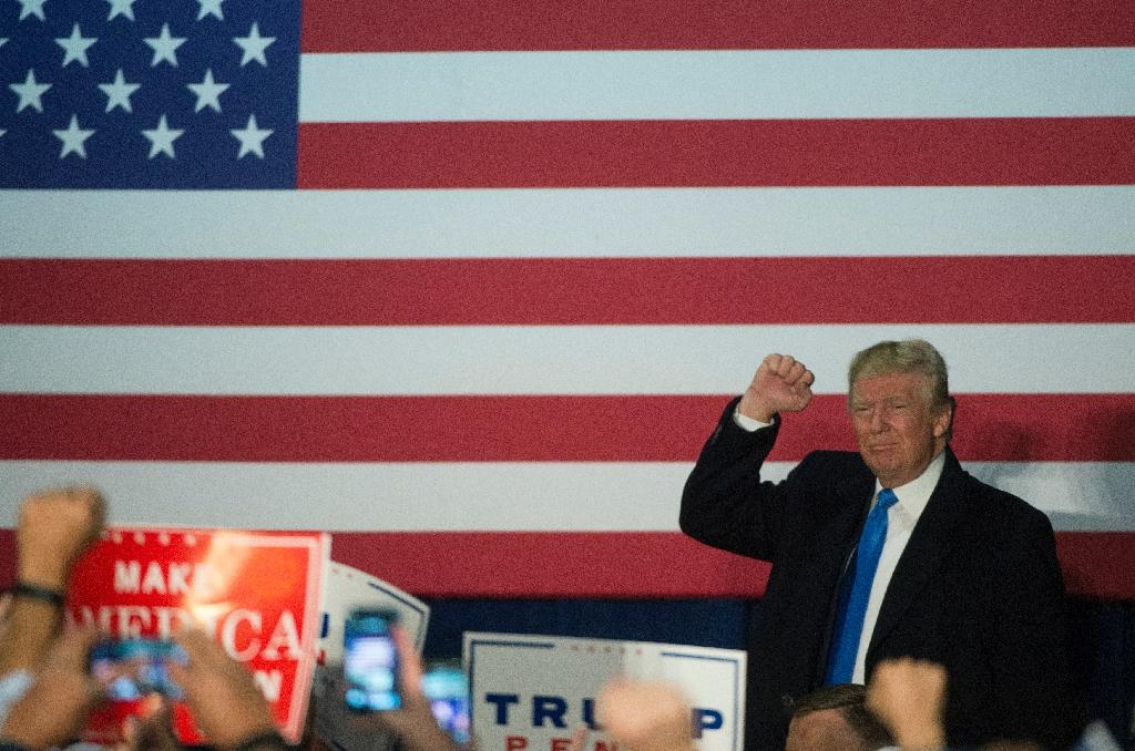 US Republican presidential candidate Donald Trump walks off stage following a campaign rally on November 7, 2016 at Loudoun Fairgrounds in Leesburg, Virginia (AFP Photo/Molly Riley)