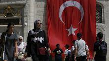 Turkish finance chief tries to reassure investors on crisis
