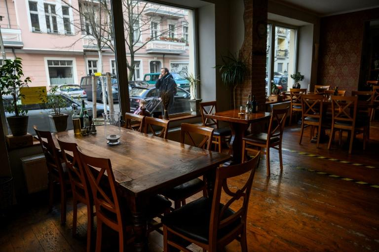 Empty tables are seen in a restaurant in Berlin's Prenzlauer Berg district (AFP Photo/John MACDOUGALL)