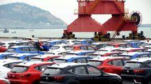 China paper warns it won't play defense on trade as Trump lauds tariffs