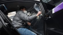 Plastic shields protect China's ride-hailing drivers against virus