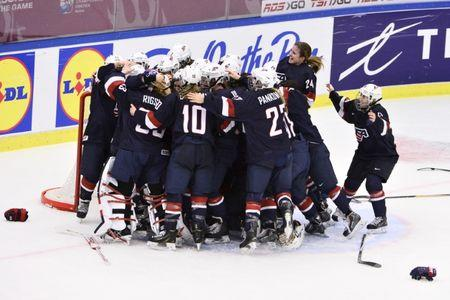 Team USA players react on winning the 2015 IIHF Ice Hockey Women's World Championship gold medal match between USA and Canada at Malmo Isstadion in Malmo