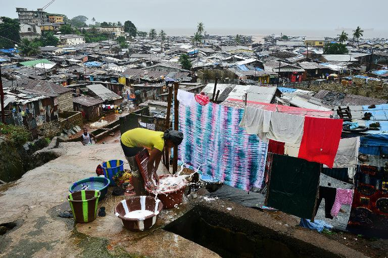 A woman washes clothes in Freetown, Sierra Leone, on August 13, 2014
