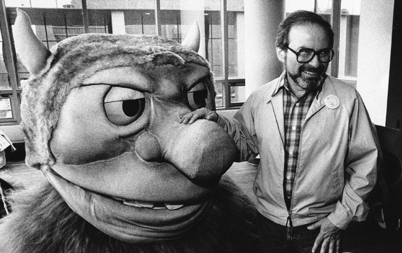 """FILE - In this Sept. 25, 1985 file photo, author Maurice Sendak poses with one of the characters from his book """"Where the Wild Things Are,"""" designed for the operatic adaptation of his book in St. Paul, Minn. Sendak died, Tuesday, May 8, 2012 at Danbury Hospital in Danbury, Conn. He was 83. (AP Photo, file)"""