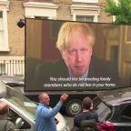 Screen showing Boris Johnson videos parks outside Cummings' home