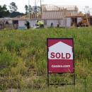 Homebuilders hold back sales amid historic demand