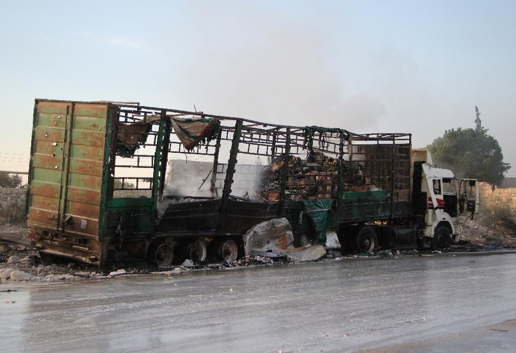 The September 19 attack on a UN-Syrian Arab Red Crescent convoy of aid trucks in the northern province of Aleppo left at least 18 dead and destroyed at least 18 of the 31 aid vehicles (AFP Photo/Omar haj kadour)