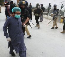 Pakistan police clash with doctors protesting lack of virus protection gear