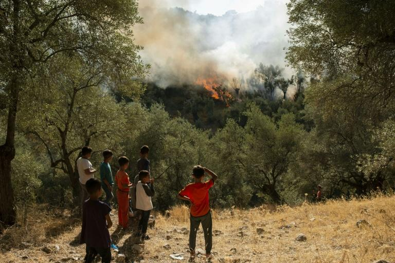 Fire, clashes, one dead at crowded Greek migrant camp on Lesbos
