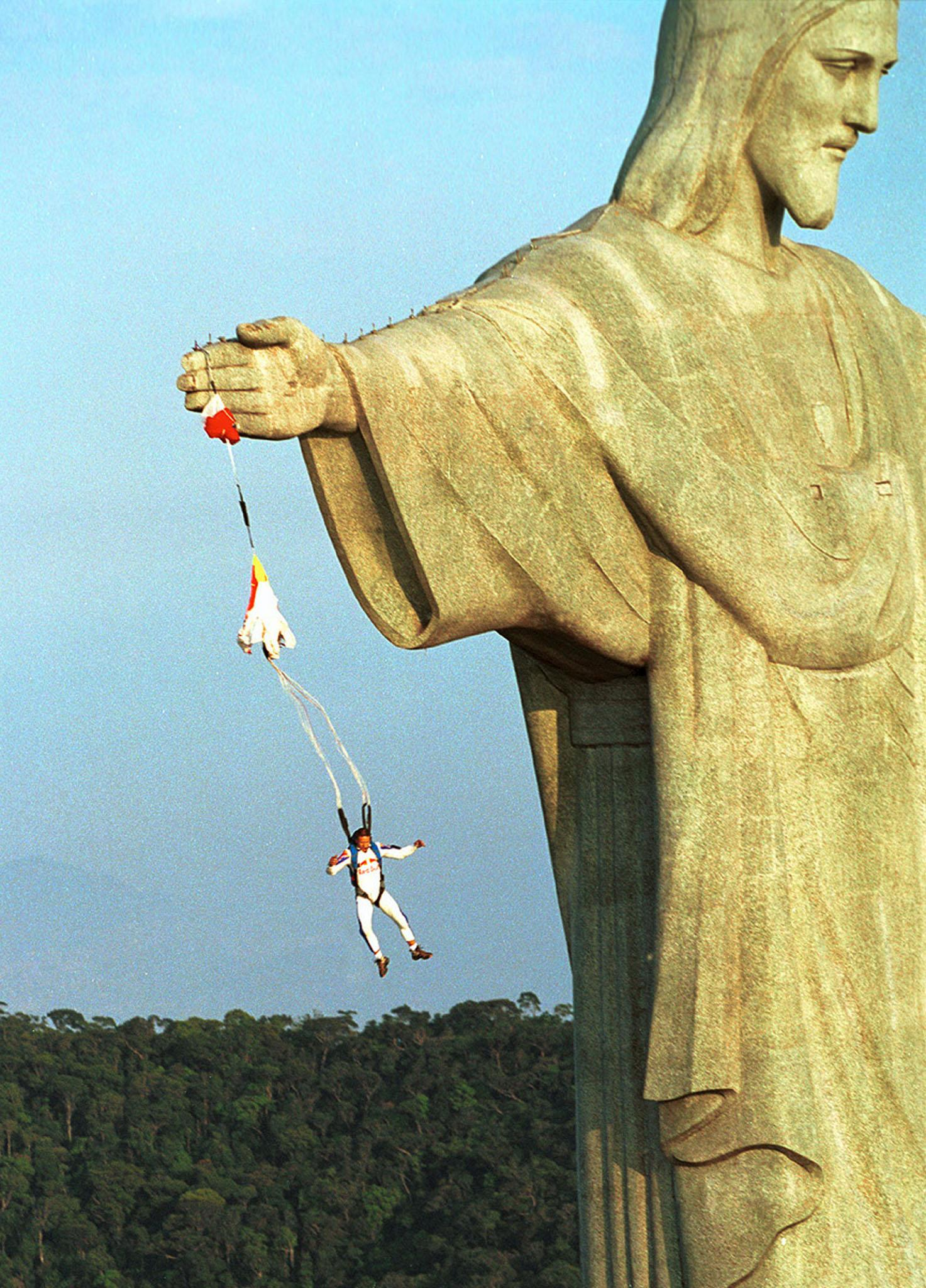 """Austrian parachuter Felix Baumgartner, who goes by the code name """"Base 502,"""" jumps from the arm of the Christ the Redeemer statue atop Corcovado mountain, overlooking Rio de Janeiro December 1. It is the first-ever known base-jump made from the site. In base-jumping, which is illegal in most countries, parachutists jump from buildings, bridges and earth points like rocks, and the parachute is only pulled open at the very last moment. Baumgartner camped out overnight at the site and used a high-tech crossbow to shoot over the arm of the 30-meter-high statue to climb up. The statue and mountain are located 747 meters above sea level. Reuters"""