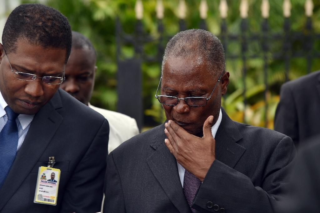 Jocelerme Privert (R), was named Haiti's acting president to replace the outgoing Michel Martelly and appointed a prime minister in late February