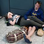 Exhausted British Airways passengers endure second day of misery at Heathrow and Gatwick
