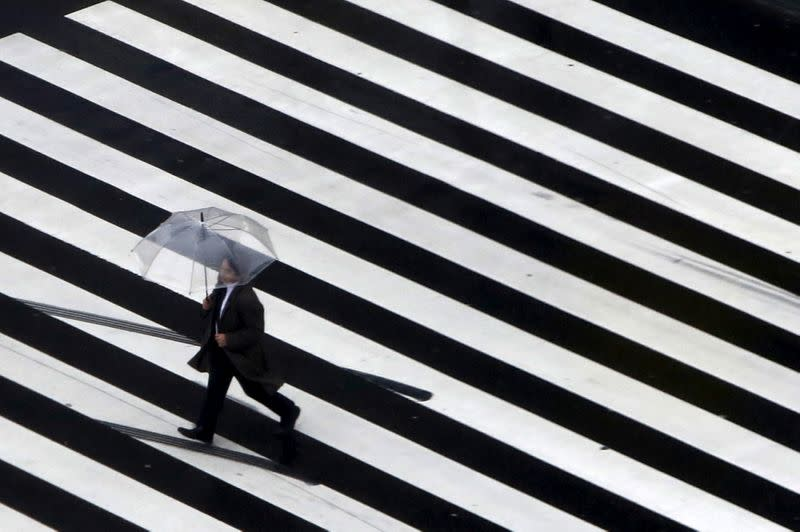 Japan's economy shrinks faster than first estimated on growing virus, recession risks
