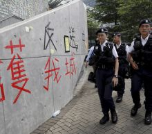 The Latest: China summons US envoy over Hong Kong criticism