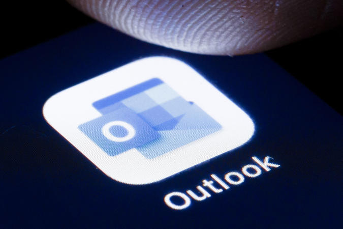 BERLIN, GERMANY - APRIL 22: The logo of the software Microsoft Outlook is shown on the display of a smartphone on April 22, 2020 in Berlin, Germany. (Photo by Thomas Trutschel/Photothek via Getty Images)