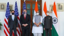 U.S. warns of threat posed by China, signs military pact with India