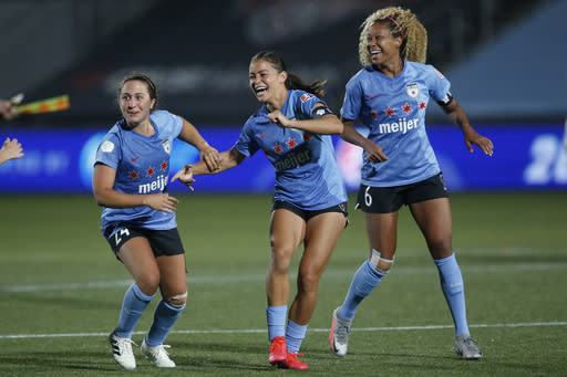 FILE- In this July 18, 2020, file photo, Chicago Red Stars' players Sarah Gordon, center, Casey Short (6) and Danielle Colaprico (24) celebrate their 4-3 win in penalty kicks against the OL Reign in an NWSL Challenge Cup soccer match in Herriman, Utah. Gordon aims to go beyond the social media statements, the T-shirts and the platitudes, and do something to lift up Black lives. The 28-year-old has put her focus on mental health for young women of color in launching her nonprofit organization, HoodSpace. (AP Photo/Rick Bowmer, File)