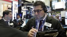 US stocks edge higher as retailers rally; oil companies fall
