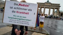 Dozens of police injured in Berlin protests against virus curbs