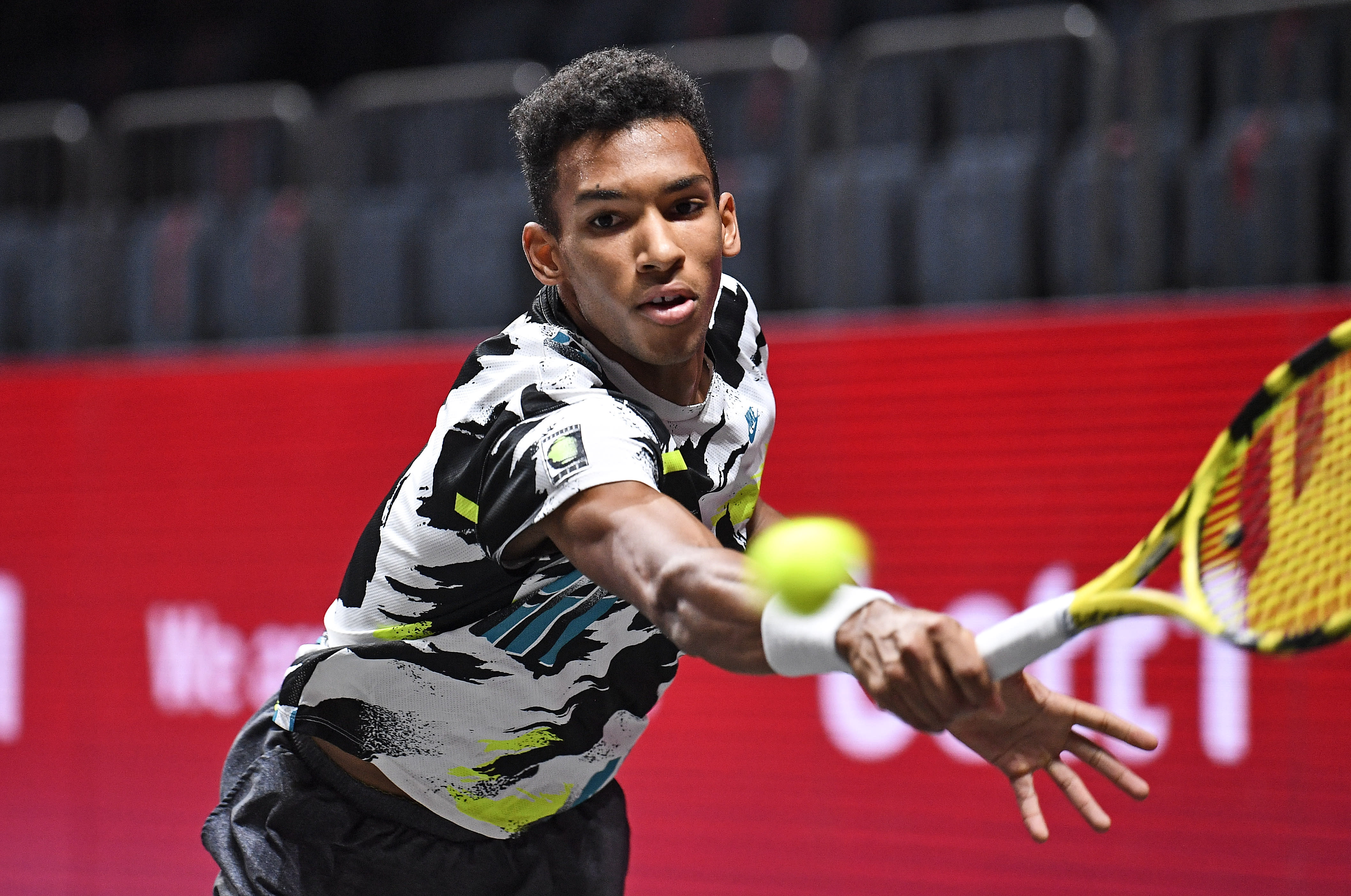 Canada's Felix Auger-Aliassime returns the ball during the ATP bett1HULKS Indoors tennis final against Germany's Alexander Zverev in Cologne, Germany, Sunday, Oct. 18, 2020. (AP Photo/Martin Meissner)