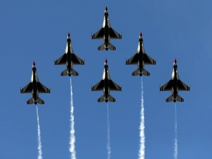 The United States Air Force Thunderbirds fly over the parade route during the 125th Rose Parade on January 1, 2014 in Pasadena, California.