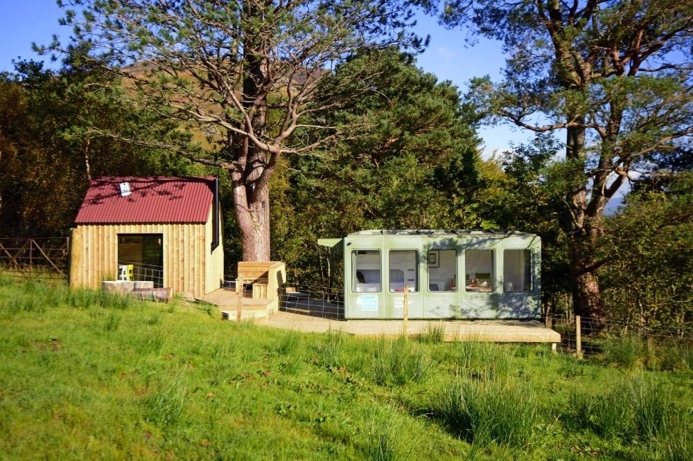 """<p>This bothy, with its huge window and splendid isolation, comes with waiting room-turned-bedroom which was once a Port Appin ferry terminal destined for the scrap heap. With thoughtful crafting, the waiting room is now a cosy bedroom and the bothy a small kitchen - both with incredible views. <a href=""""https://www.canopyandstars.co.uk/britain/scotland/perthshire/mhor/the-ferry-waiting-room"""" target=""""_blank"""">The Ferry Waiting Room</a> sleeps a family of four in a double bed and set of single bunk beds. It is idyllically located in the Highland wilderness so you can enjoy hikes, climb Ben More or go fishing in the loch. From £140 per night.</p>"""