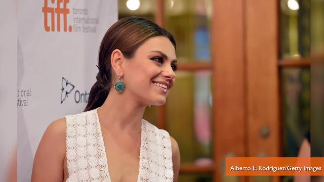 Mila Kunis Attends TIFF Premiere, No Engagement Ring In Sight