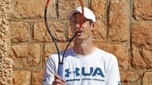 Andy Murray advances in Barcelona Open after Tomic pulls out