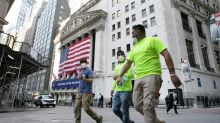 Wall Street closing higher, ending erratic week of trading