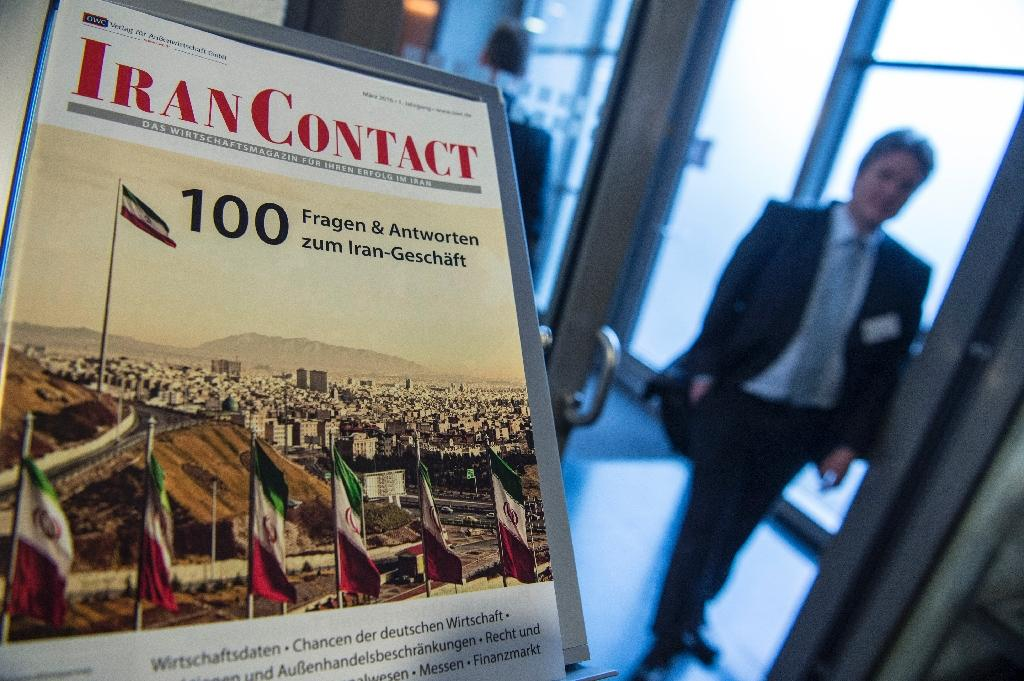 A brochure answering questions on investment in Iran is seen at the German-Iranian Business Forum in Berlin (AFP Photo/John MacDougall)