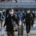 China reports major drop in new virus cases as death toll rises to 1,523