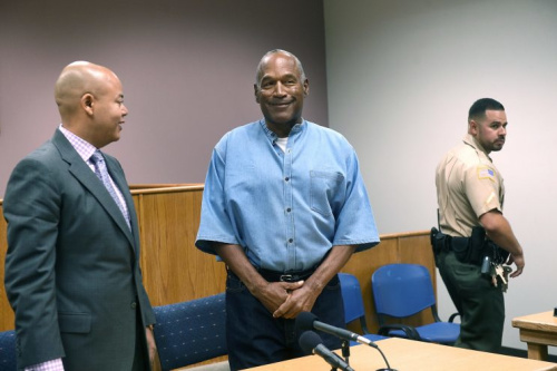 O.J. Simpson smiles after arriving at his parole hearing on Thursday morning (Getty Images).