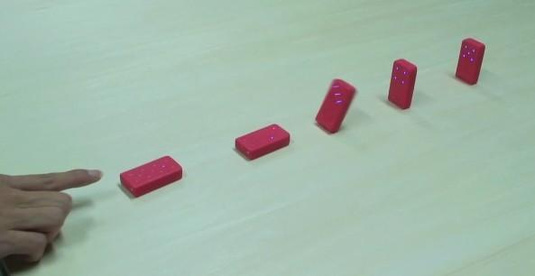 Esper Dominoes topple without touching, we fall all over ourselves (video)