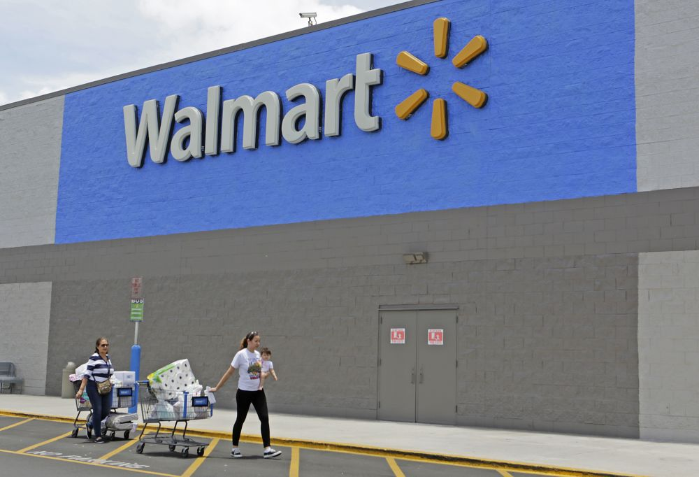Customers walk out of a Walmart store in Florida