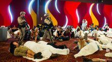 Las Vegas massacre casts somber mood on conferences, but events go on