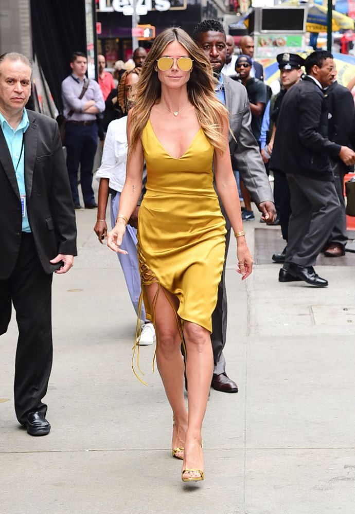 Heidi Klum Stops Traffic In Gold Dress