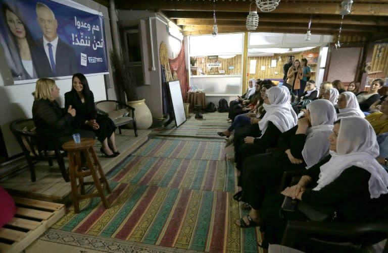 Retired Israeli army general Orna Barbivay (L) and Gadeer Kamal Mreeh speak at a conference in the northern Israeli Druze village of Daliyat al-Karmel on August 29, 2019 (AFP Photo/JALAA MAREY)