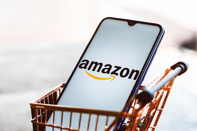 BRAZIL - 2021/09/01: In this photo illustration, an Amazon logo seen displayed on a smartphone along with a shopping cart. (Photo Illustration by Rafael Henrique/SOPA Images/LightRocket via Getty Images)