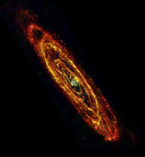 ESA Herschel space observatory image of Andromeda (M31) using both PACS and SPIRE instruments to observe at infrared wavelengths of 70 mm (blue), 100 mm (green) and 160 mm and 250 mm combined (red). Image released Jan. 28, 2013.