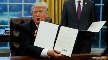 Trump signs order to pull out of TPP