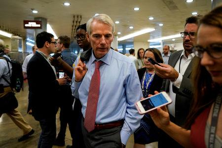 FILE PHOTO: Sen. Rob Portman (R-OH) speaks with reporters on the way to the Senate floor on Capitol Hill in Washington