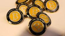 Bitcoin plummets below $11,000