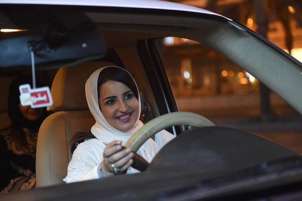 For now, the women taking to the roads appear mainly to be those who have swapped foreign licences for Saudi ones (AFP Photo/FAYEZ NURELDINE)
