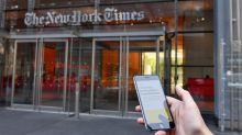 New York Times stock soars to 15-year high after earnings beat, dividend hike and debts paid off