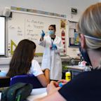 Children over 11 and teachers to wear face masks at French schools as debate in Italy continues