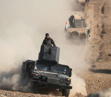 Iraqi forces punch into western Mosul, launch air strikes in Syria